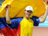 Juan Sebastian Gomez of Colombia celebrates after winning the boys' tennis singles final against Yuki Bhambri of India