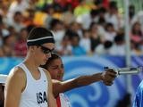 Leydi Laura Moya Lopez (R) of Cuba and Nathan Schrimsher of USA practice before the shooting of Mixed Relay of Modern Pentathlon. Leydi Laura Moya Lopez and Nathan Schrimsher are in the same team in the event.