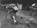 London 1948: G Rossi of Switzerland changes his tyre during the cycling event at Windsor Great Park.