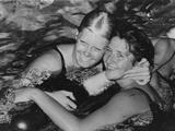 Rome 1960: Australia's Dawn Fraser (right) is congratulated in the water by G. Von Saltza (USA) after equalling the world record when she won the 100m freestyle final. Frasers's winning time was 61.2 seconds.