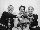 Tokyo 1964: Medallists in the 100m freestyle swimming event. Left to right: silver medallist Sharon Stouder (USA), third time gold medallist Australia's Dawn Fraser and bronze medallist Kathleen Ellis (USA). Fraser is holding up her lucky kangaroo mascot.