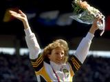 Australia's Debbie Flintoff-King celebrates her gold medal win in the 400m hurdles.