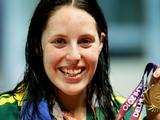 Alicia Coutts poses with the gold medal during the medal ceremony for the Women's 100m Freestyle Final at the Delhi 2010 Commonwealth Games.