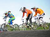 (left to right) Mayara Perez of Brazil, Maartje Hereijgers of the Netherlands, and Kristen Dellar of Australia prepare to go down a slope during the junior womens' BMX final. Brazil won the Gold, Australia the Silver, and the Netherlands the Bronze.