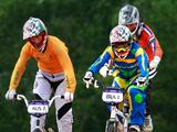 Kirsten Dellar (left) of Australia races with Mayara Perez (right) of Brazil to the finishing line as they compete in the Junior Women's BMX Cycling final. Mayara took 1st place with a time of 35.698 sec. and Kirsten came in 2nd place with a time of 36.133 sec.