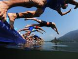 Competitors dive in for the swimming portion of the Mens Triathlon Final at the Triathlon Venue.