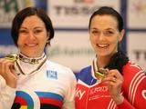 Anna Meares of Australia stands alongside Victoria Pendleton (silver) after winning the Women's Sprint during day four of the UCI Track World Championships at the Omnisport arena in Apeldoorn, Netherlands.