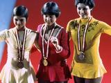 Innsbruck 1976: Dorothy Hamill from the United States in the centre smiles while wearing her gold medal for the in the women's figure skating competition.