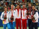 (L-R) Simon Aspelin and Thomas Johansson of Sweden, silver, Roger Federer and Stanislas Wawrinka of Switzerland, gold, and Bob Bryan and Mike Bryan of the United States, bronze, receive their medals for the men's doubles tennis.