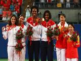 Venus Williams and Serena Williams of the United States celebrate the gold medal with silver medalists Virginia Ruano Pascual and Anabel Medina Garrigues of Spain and bronze medalists Yan Zi and Zheng Jie of China after the Women's Doubles Gold medal match.