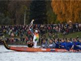 The torchbearer accompanied by a rowing fleet held the Olympic Torch while the leading dragon boat aross Volga river.