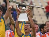 Jamie Dwyer of Australia holds up the 2011 Men's Champions Trophy in Auckland, New Zealand after defeating Spain 1-0. The Kookaburras became the first team to win the Champions Trophy four years in a row.