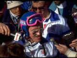 Michael 'Eddie the Eagle' Edwards of Great Britain is mobbed by reporters during the 90m ski jump competition. Eddie the Eagle finished in last place but was much loved by the spectators.