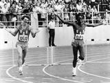 Montreal 1976: Edwin Moses, the American athlete, running a lap of honour after winning the final of the men's 400m hurdles. Pictured with him is Michael Shine, the American athlete who won the silver.