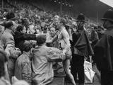 London 1948: Henry Eriksson (SW) winner of the men's 1,500m, being congratulated by compatriots in the stand.
