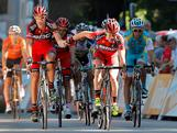 Cadel Evans (R) riding for BMC Racing crosses the finish line in hand with teammate George Hincapie (L) of the USA in 35th and 36th place during stage sixteen of the 2012 Tour de France from Pau to Bagneres-de-Luchon on July 18, 2012 in Bagneres-de-Luchon, France. Evans dropped to seventh place in the general classification with the result.