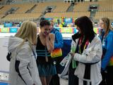Chantelle gets off the ice after her stunning short program and is congratulated by mum and coach Monica and Chef de Mission Alisa Camplin.
