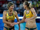Nat Cook (L) and Tamsin Barnett win a point against Andrezza Chagas and Cristine Santanna of Georgia during the beach volleyball event at the Beijing 2008 Olympic Games.