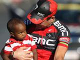 Cadel Evans of BMC Racing poses with his son during a processional lap after the twentieth and final stage of the 2012 Tour de France, from Rambouillet to the Champs-Elysees on July 22, 2012 in Paris, France.