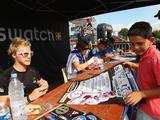 Sam Willoughby (l), Laetitia le Corguille (2nd l) of France, Martijn Scherpen (2nd r) of Holland and Robert de Wilde (far r) at an autograph signing session during the UCI BMX Supercross World Cup at Roc d'Azur Frejus on October 10, 2009 in Frejus, France.