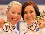 Kaarle McCulloch and Anna Meares of Australia stand on the podium after winning back-to-back world track cycling titles in the Women's Team Sprint at the UCI Track World Championship in Apeldoorn, Netherlands. Anna and Kaarle beat out Britains Jessica Varnish and Victoria Pendleton to take the title.