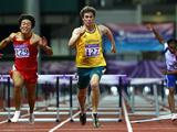 Nicholas Hough wins the Boys 110 metres hurdles A final from Dongqiang Wang of China