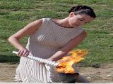 Maria Nafplotou lights the olympic flame during the Lighting Ceremony of the Olympic Flame for the Vancouver 2010 Winter Olympic Games at the Ancient Olympia site in Olympia, Greece.(Photo by Milos Bicanski/Getty Images)