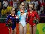 Shawn Johnson of the United States poses with the silver medal, Sandra Izbasa of Romania poses with the gold medal and Nastia Liukin of the United States poses with the bronze medal in the women's individual floor final in the artistic gymnastics event.