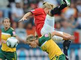 Lene Mykjaland of Norway jumps above Elise Kellond-Knight of Australia during the FIFA Women's World Cup 2011 Group D match between Australia and Norway in Leverkusen, Germany.