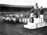 London 1948: Captains of the football teams stand on the medal podium listening to the Swedish national anthem at the medal ceremony for the football competition where Sweden won the gold medal, Yugosalvia the silver and Denmark finished third to win bronze.
