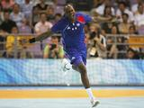 Olivier Girault of France celebrates after scoring in the Men's Quarterfinal match between France and Russia at the Olympic Sports Centre Gymnasium.