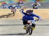 Anne-Caroline Chausson of France crosses the line to win the gold medal in the women's BMX final held at the Laoshan Bicycle Moto Cross Venue during Day 14 of the Beijing 2008 Olympic Games on August 22, 2008 in Beijing, China.