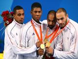 (L-R) Jean-Michel Lucenay, Ulrich Robieri, Jerome Jeannet and Fabrice Jeannet of France wave to the crowd after winning the gold medal in the men's team epee fencing event at the Fencing Hall on Day 7 of the Beijing 2008 Olympic Games on August 15, 2008 in Beijing, China.