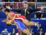Men's 46kg freestyle wrestling Artak Hovhannisyan (Blue) from Armenia, celebrates by unexpectedly tossing his opponent, Venezuela's Andry Davila (red), in the air, as he is announced the winner of the bronze medal match.