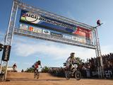 Sam Willoughby (r) wins the men's elite final and claim overall World Cup number one status as Donny Robinson (l) of USA finishes in second place during the UCI BMX Supercross World Cup at Roc d'Azur Frejus on October 10, 2009 in Frejus, France.