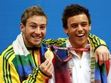 (L to R) Matthew Mitcham (silver) and Tom Daley (gold) of England pose with the medals won in the Men's 10m Platform Final at the Delhi 2010 Commonwealth Games.