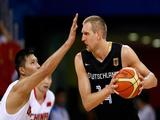 Dirk Nowitzki #14 of Germany is guarded by Yi Jianlian #11 of China during the group B preliminary basketball game.