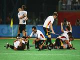 The German team celebrates after winning the Men's Gold Medal Match between Germany and Spain held at the Olympic Green Hockey Field.