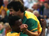 Aziz Behich and Kofi Danning celebrate after Jason Hoffman scored his teams second goal during the first 2012 London Olympic Games Asian Qualifier match between the Australian Olyroos and Yemen.