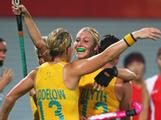 Casey Eastham (back) celebrates a goal with her team mates Shelly Liddelow (#13) and Madonna Blyth (#12) during the Women's Hockey Pool match between Australia and Korea held during the Beijing 2008 Olympic Games. Australia went on to win the match 5-4.
