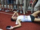 Gold medalist Kim Dae Beom (C) rests on the track after the Boys` Individual Final of Modern Pentathlon