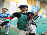 Gold medalist Du Li of China celebrates after winning the Women's 50m Rifle 3 Position Final.