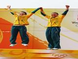 (L-R) Elise Rechichi and Tessa Parkinson of Australia celebrate winning the Women's 470 class event held at the Qingdao Olympic Sailing Center.