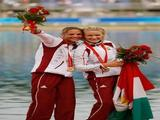 (L-R) Katalin Kovacs and Natasa Janic of Hungary celebrate with their gold medals for winning the Kayak Double (K2) 500m Women Final during the canoe/kayak flatwater event held at the Shunyi Olympic Rowing-Canoeing Park on Day 15 of the Beijing 2008 Olympic Games on August 23, 2008 in Beijing, China.