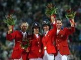 The gold medal team from the United States (L-R) Will Simpson,Laura Kraut, Beezie Madden, McLain Ward after winning The Team Jumping Competition.