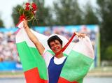 <p>Rumyana Neykova of Bulgaria looks on after winning the gold medal in the Women's Single Sculls Final. </p>
