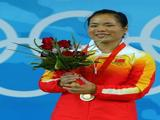 Gold medalist Chen Yanqing of China stands on the podium during the medal ceremony for the Women's 58kg group A weightlifting event.