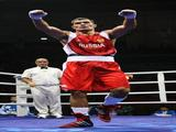 Rakhim Chakhkiev of Russia celebrates victory against Clemente Russo of Italy in the Men's Heavy (91kg) Final Bout held at Workers' Indoor Arena on Day 15 of the Beijing 2008 Olympic Games on August 23, 2008 in Beijing, China.