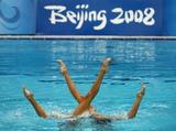 Anastasia Davydova and Anastasia Ermakova of Russia compete in the Synchronised Swimming Duet Free Routine Final at the National Aquatics Centre.