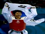 Gold medalist Son Taejin of South Korea celebrates winning the Men -68kg Taekwondo gold medal contest